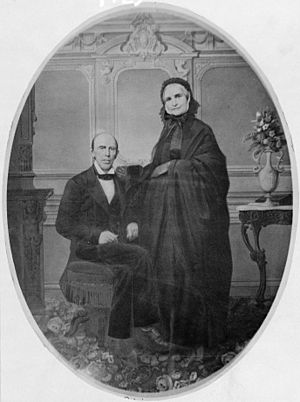 Francis Preston Blair seated and his wife standing alongside, full length portrait