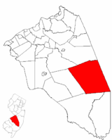 Woodland Township highlighted in Burlington County. Inset map: Burlington County highlighted in the State of New Jersey.