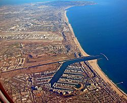 Aerial view of Marina del Rey, with Los Angeles International Airport and Palos Verdes Peninsula in the background.
