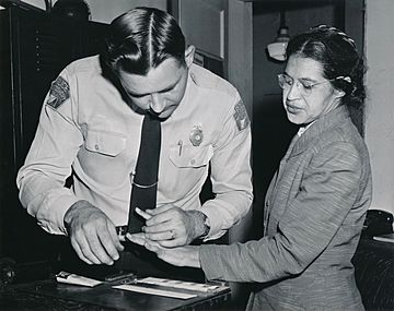 Rosa Parks being fingerprinted by Deputy Sheriff D.H. Lackey after being arrested for refusing to give up her seat for a white passenger on a segregated municipal bus in Montgomery, Alabama