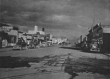 Fourth Avenue, which emerged as the early town's main east-west street, as it appeared in 1944 (left) and 1953 (right), both views looking east towards the Fourth Avenue Theatre and the Federal Building.