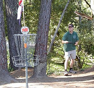 Disc golfer and basket.jpg