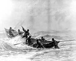 A Life-Saving crew launches a surfboat through heavy surf. Courtesy of U.S. Coast Guard Historian's office