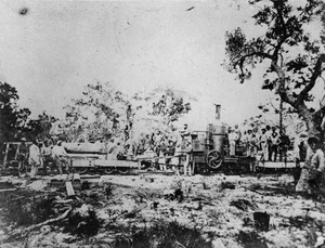 Workers standing on the Mary Ann first steam locomotive built in Queensland, 1875f