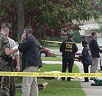 US Army CID agents at crime scene