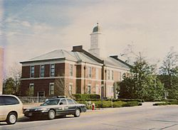 The 1904 Onslow County Courthouse with Highway Patrol car parked on the corner of Old Bridge and Court Streets.