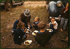 Homesteader and his children eating barbeque at the New Mexico Fair. Pie Town, New Mexico, October 1940