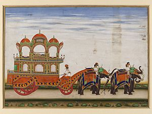 A two-tiered carriage drawn by four elephants