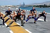 US Navy 060627-N-5290S-097 Gilad of the Fit TV show, Bodies in Motion, films a show aboard the amphibious assault ship USS Bonhomme Richard (LHD 6)