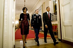 Defense.gov News Photo 101115-A-0193C-016 - President Barack Obama right Staff Sgt. Salvatore Giunta and First Lady Michelle Obama enter the East Room of the White House to begin the Medal